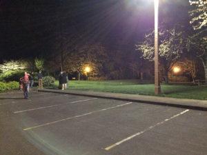 Parking lot lit at night.